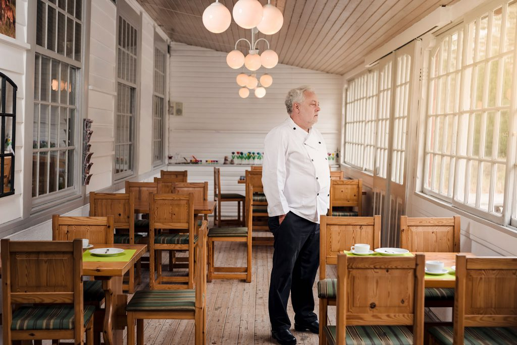 Business owner standing in empty restaurant