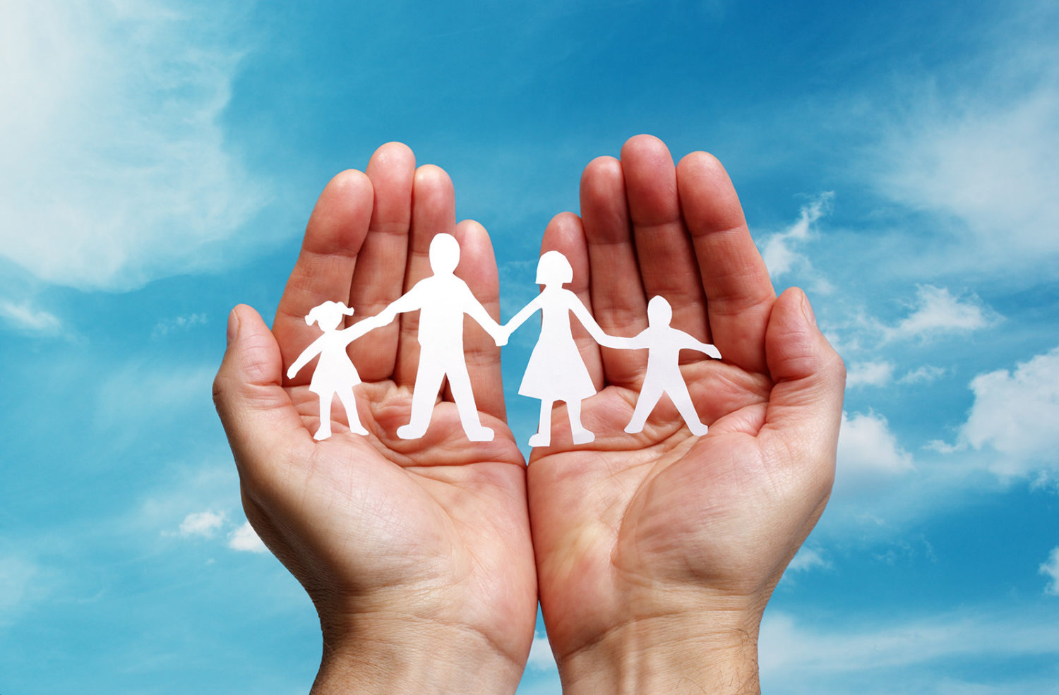 Man holding cutout paper people family