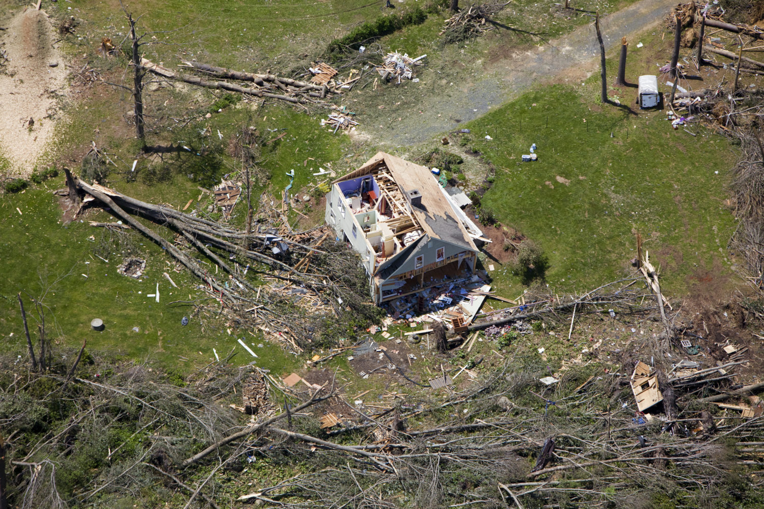 a home missing their roof after a tornado