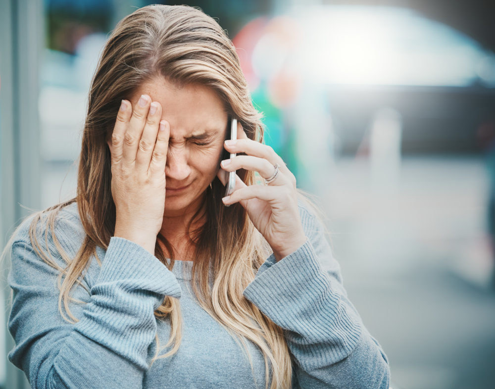 woman calling her insurance provider after Hurricane Sally