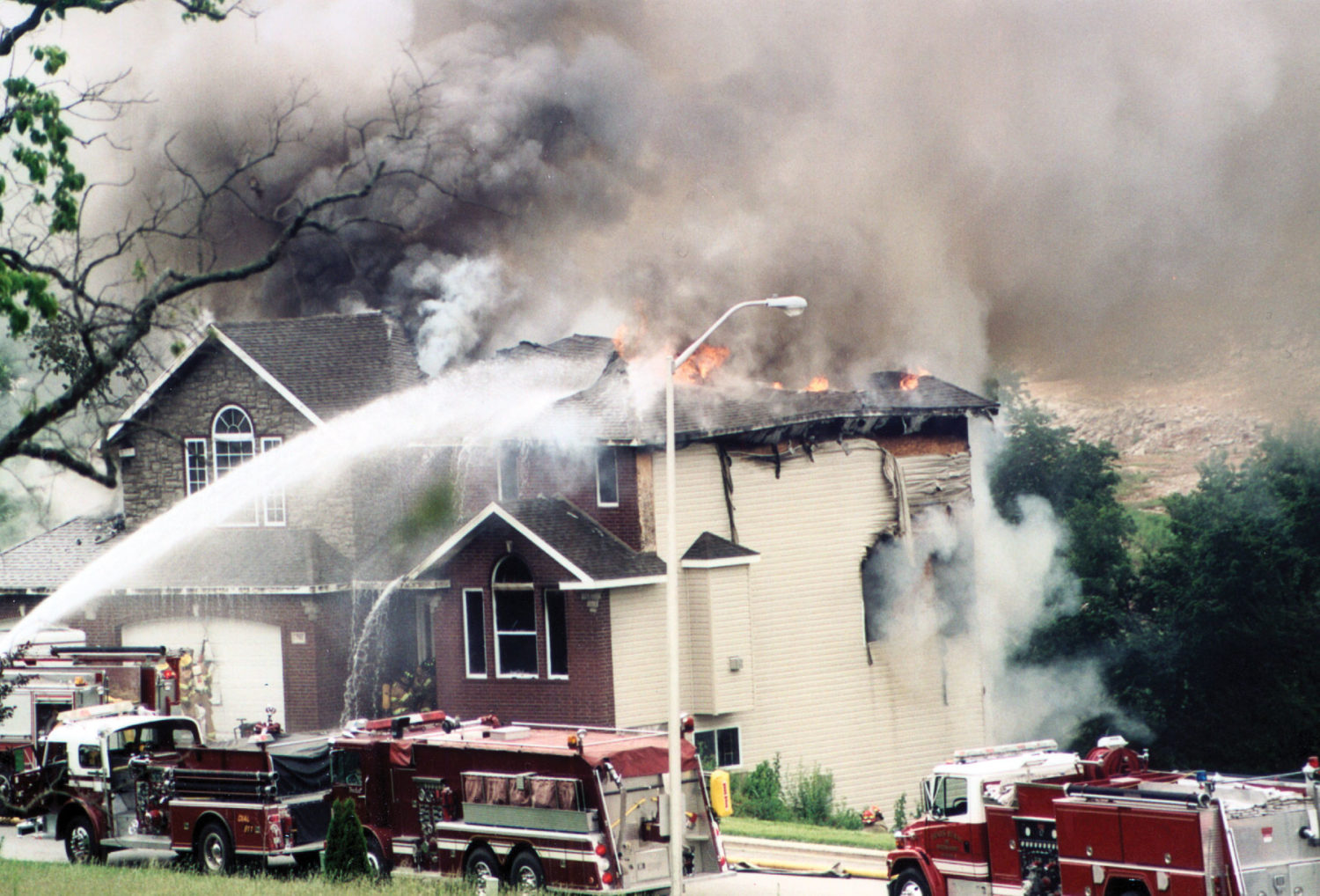 home experiencing fire damage in Mobile, AL