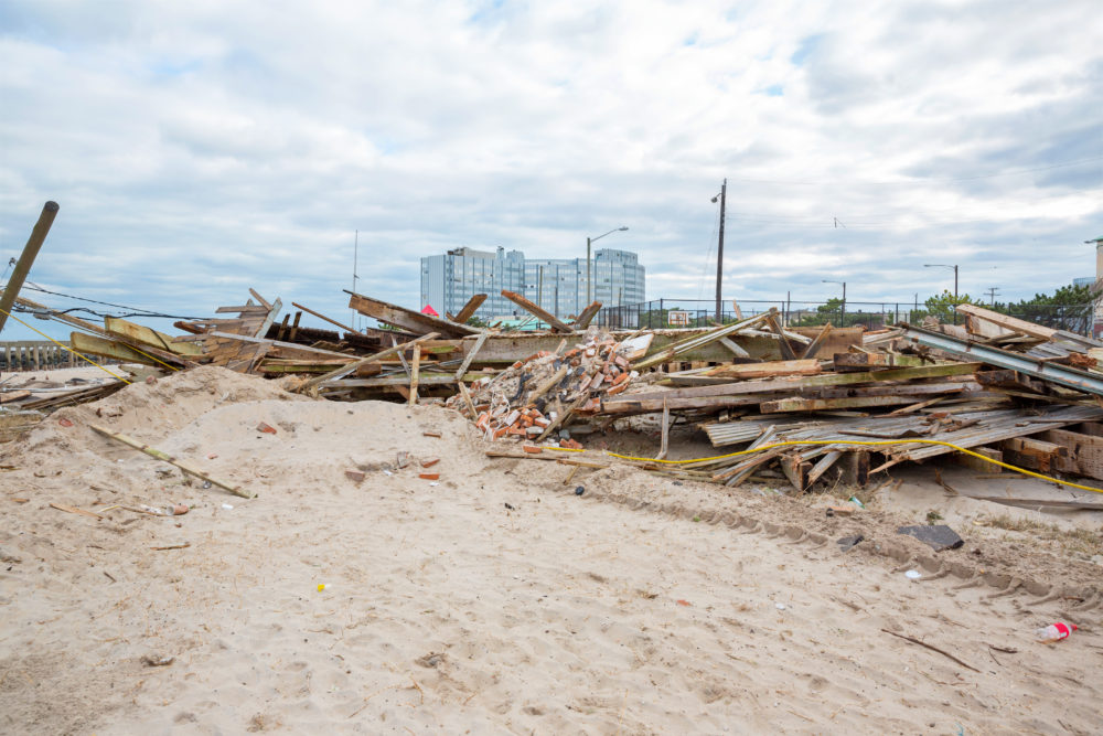 beach covered with debris after Hurricane Sally