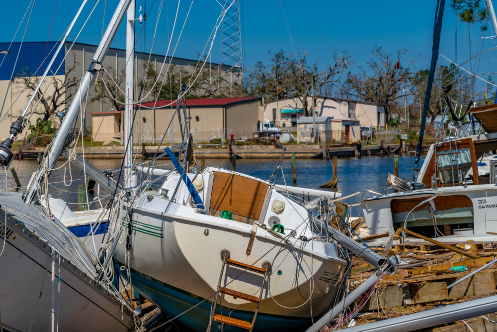 boats in a harbor destroyed after Hurricane Delta
