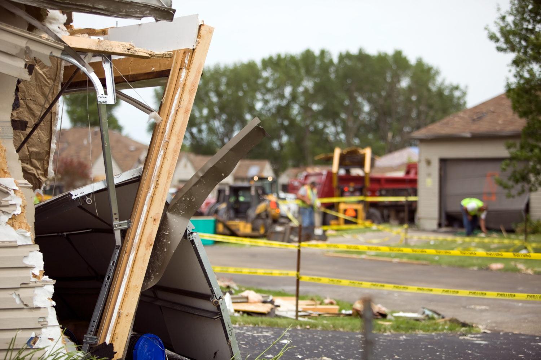 tornado damage clean up beginning in a Birmingham, AL, neighborhood