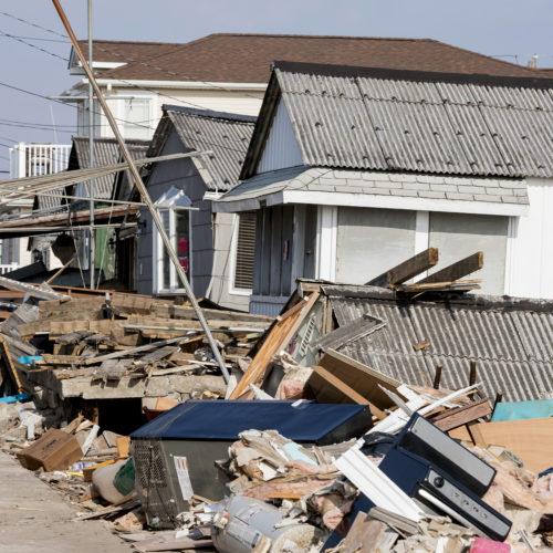 debris set out in front of homes after the Hurricane Delta clean-up