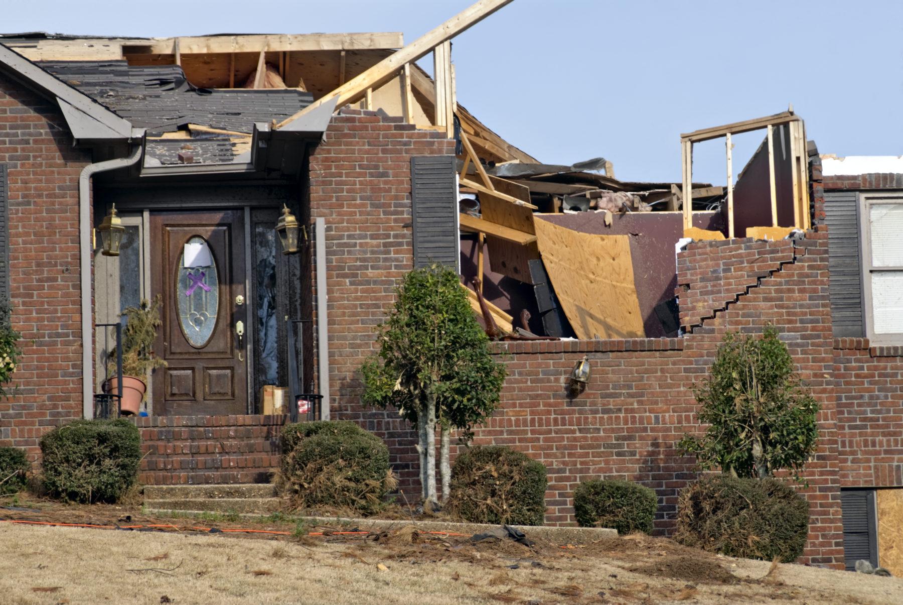 a home in Birmingham, AL, with severe tornado damage