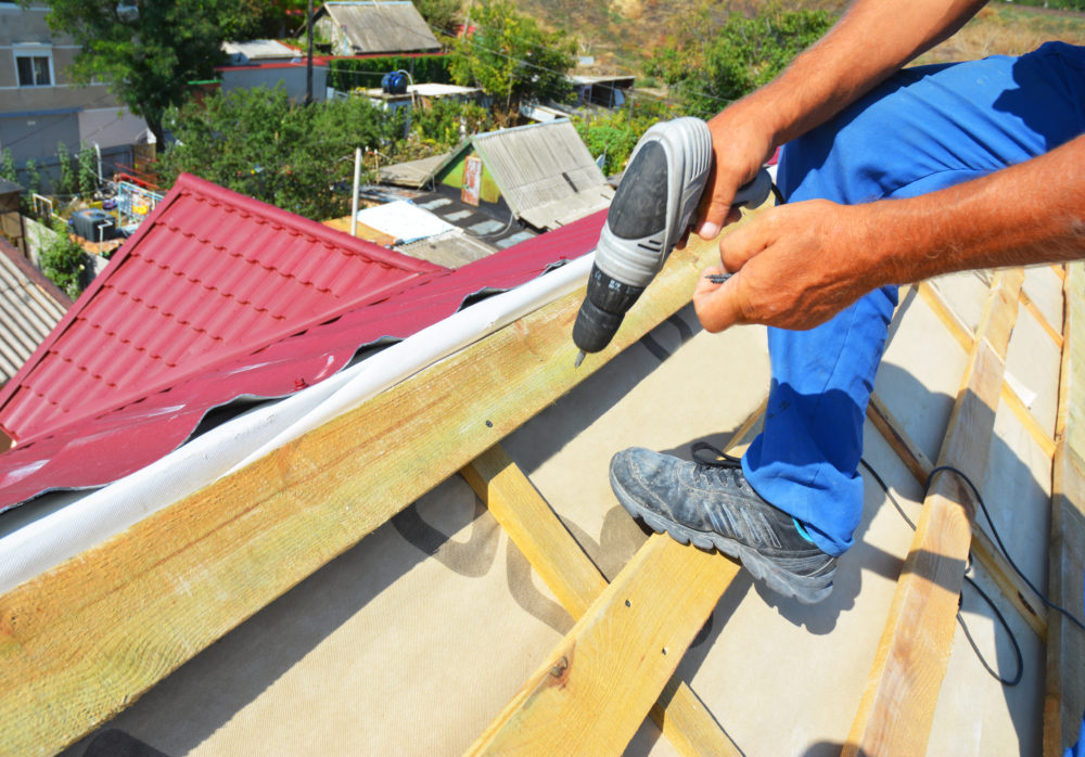 a roof being repaired after suffering damage from Hurricane Sally