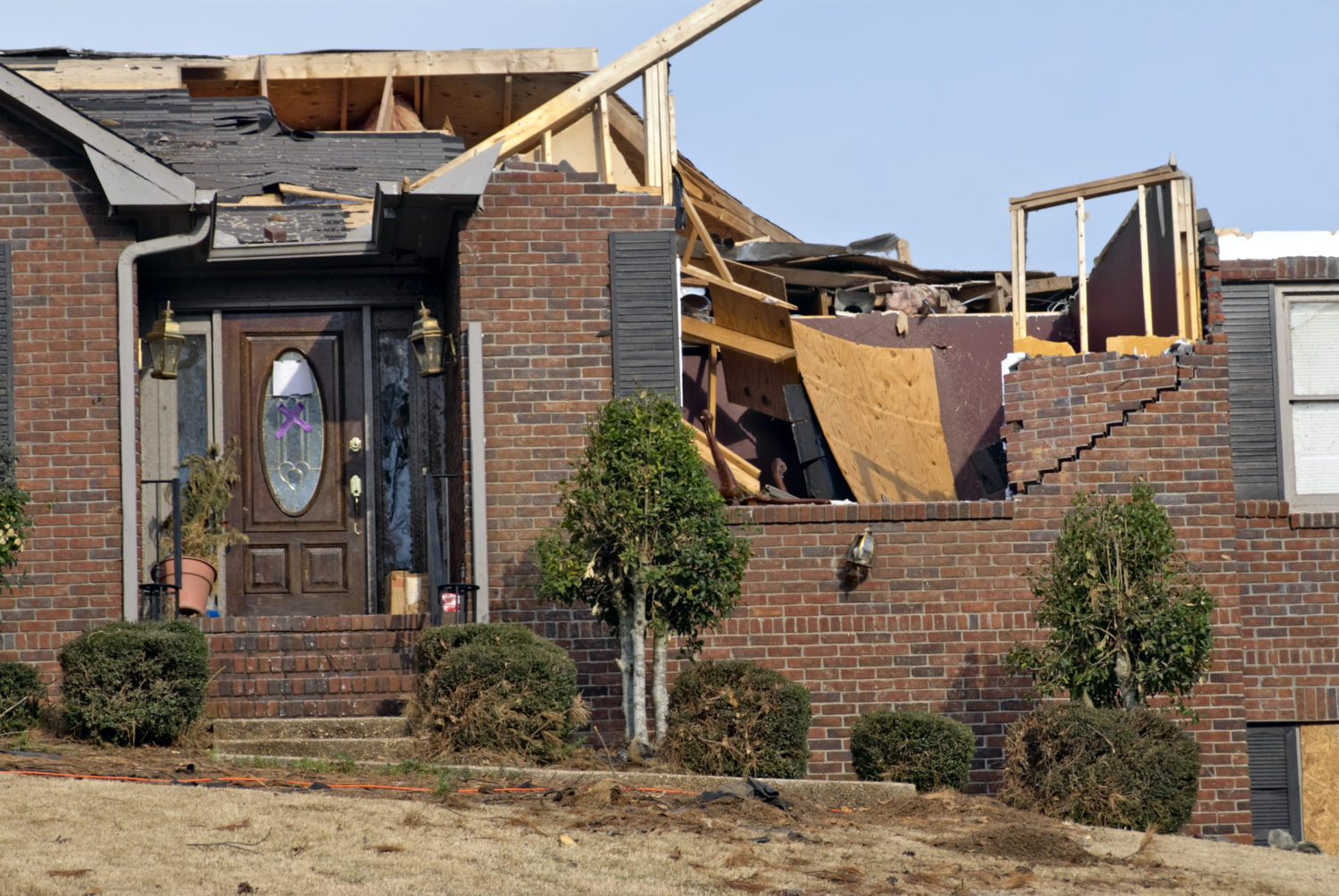 Brick home damaged by a tornado in Mississippi