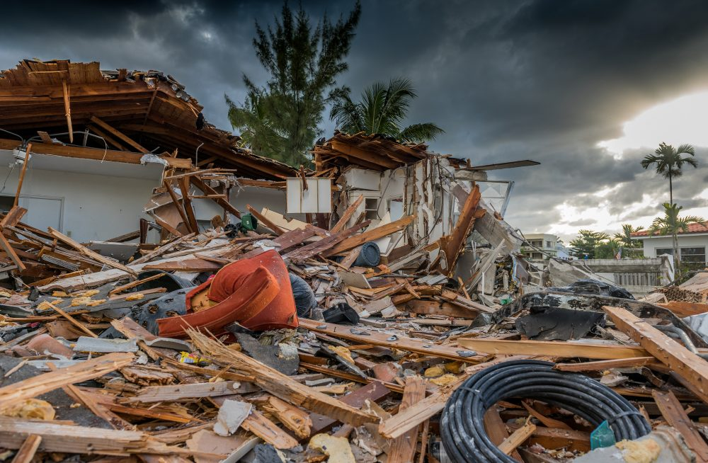 Debris from a home severely damaged by a hurricane.