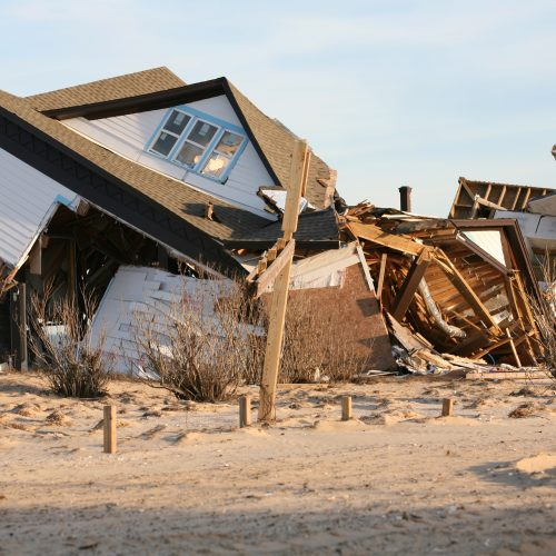 A beach house that has been severely damaged by a hurricane.