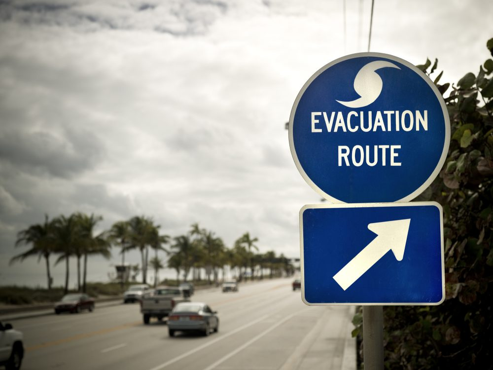 An evacuation route sign on the highway.
